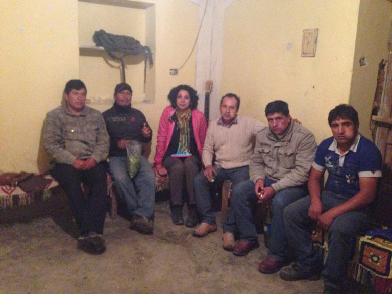 """The ronderos patrolmen, joined by the author, meet at leader Eduar Rodas Rojas home to determine their next legal actions against the Chadin 2 hydroelectric project. Notice the bulging cheeks of the men chewing coca leaves, an indigenous tradition known as """"chacchar."""" Photo credit: Verónica Goyzueta."""