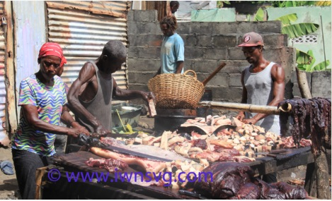 People process orca meat and blubber in the town of Barrouallie in July. Photo credit: http://www.iwnsvg.com.