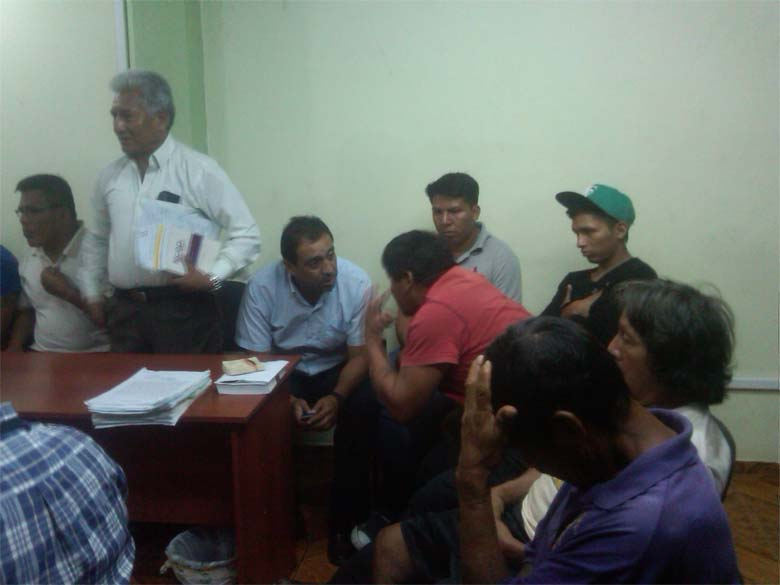 Waorani Indians in El Coca police station waiting to be sent to Lago Agrio prison in January. Photo credit: Human Rights Commission of Orellana.