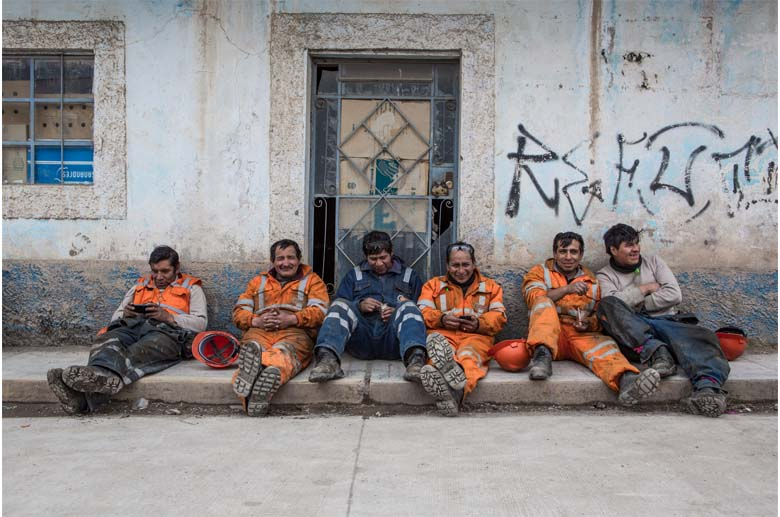 Several of the 2,000 miners in Corquijilca Pasco, Peru, on lunch break. Peru's extraction industry has provided jobs and helped lift rural people out of poverty, but often at a high cost to the environment. Photo by Jason Houston.