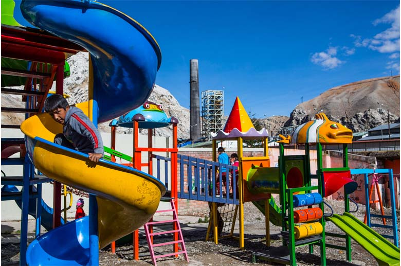 1.A playground sits directly across the river from La Oroya's now closed, but heavily polluting smelting plant, that the town's people want re-opened. Photo by Jason Houston.