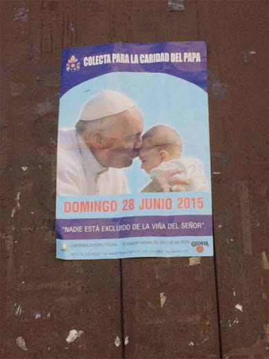 A poster announces Pope Francis' visit to Peru this summer to speak about his encyclical on the environment. His visited the US in September. Photo by Jason Houston.