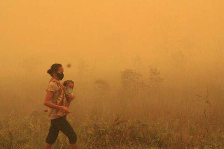 "Indonesia on fire, October 16, 2015. An image posted on Twitter purporting to show the smoke-choked city of Palangkaraya. Damages from the record wildfires has already topped US $30 billion; acrid smoke has sickened half a million people. ""This is my urgent call… Guarantee the future of Oceania. Change society to a low-carbon lifestyle,"" said Monsignor John Ribat, President of the Federation of Catholic Bishops' Conferences of Oceania and the Archbishop of Port Moresby, Papua New Guinea."