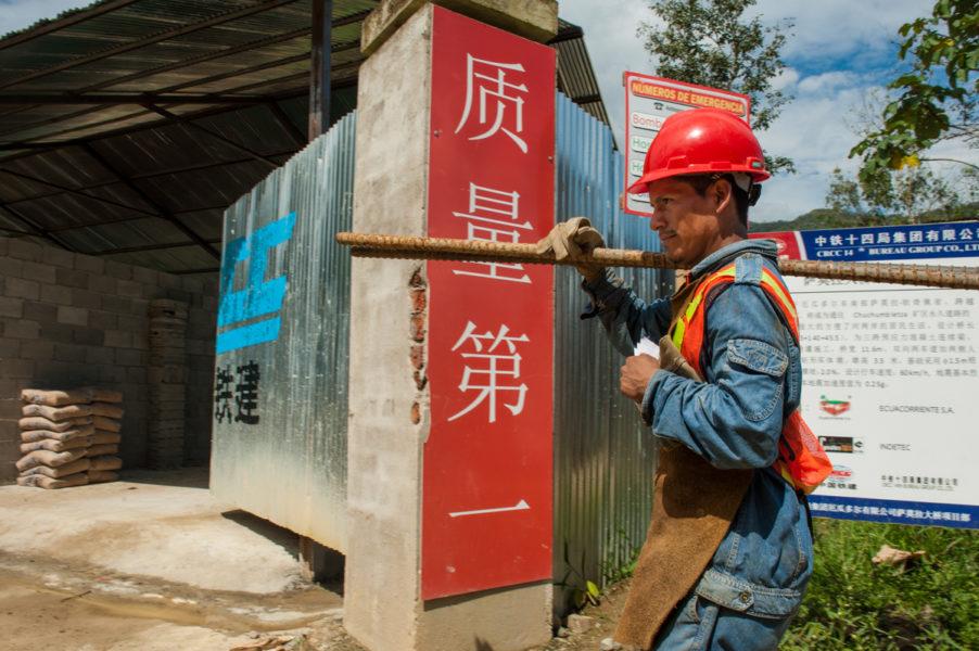 A Shuar man works on a bridge near the proposed Mirador Mine. Photo by Beth Wald.