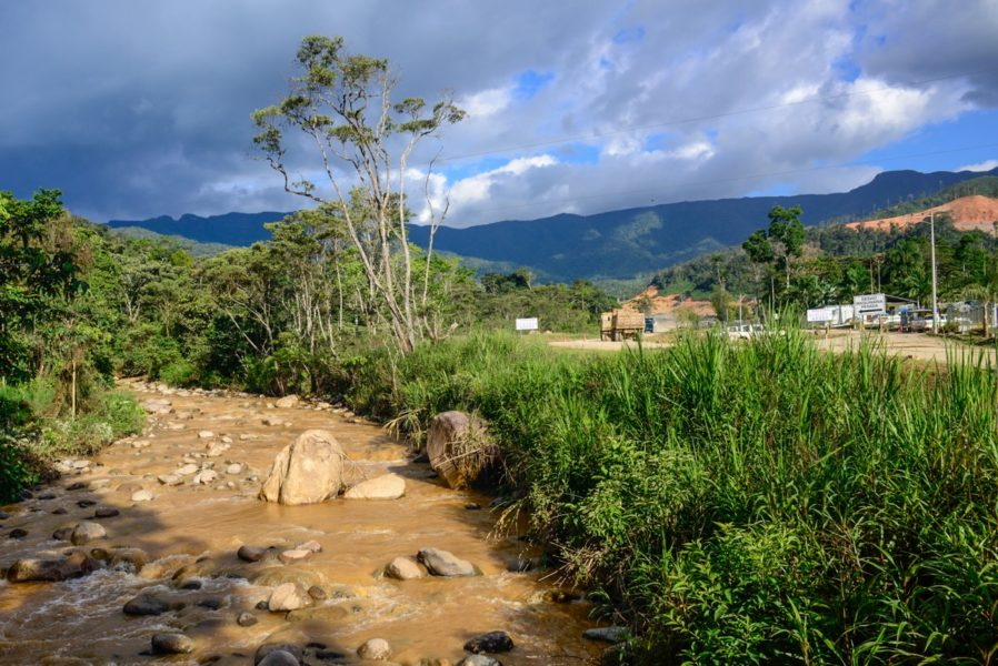 The Rio Wawayme , choked with sediment from construction of roads and infrastructure for the Mirador Mine, flows past a camp being built for mine workers, December 8, 2015. Photo by Beth Wald.