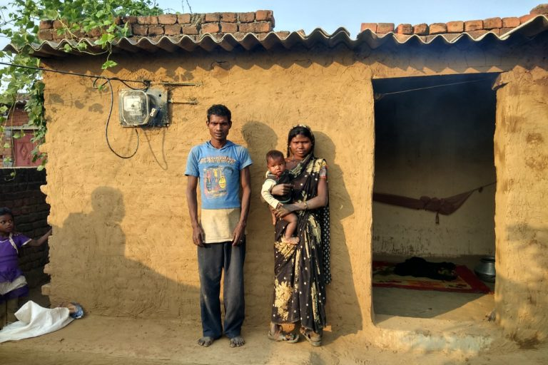 Ramlalu Baiga, who was displaced from his land for a coal mine, with his family. Photo credit: Mayank Aggarwal/Mongabay-India.