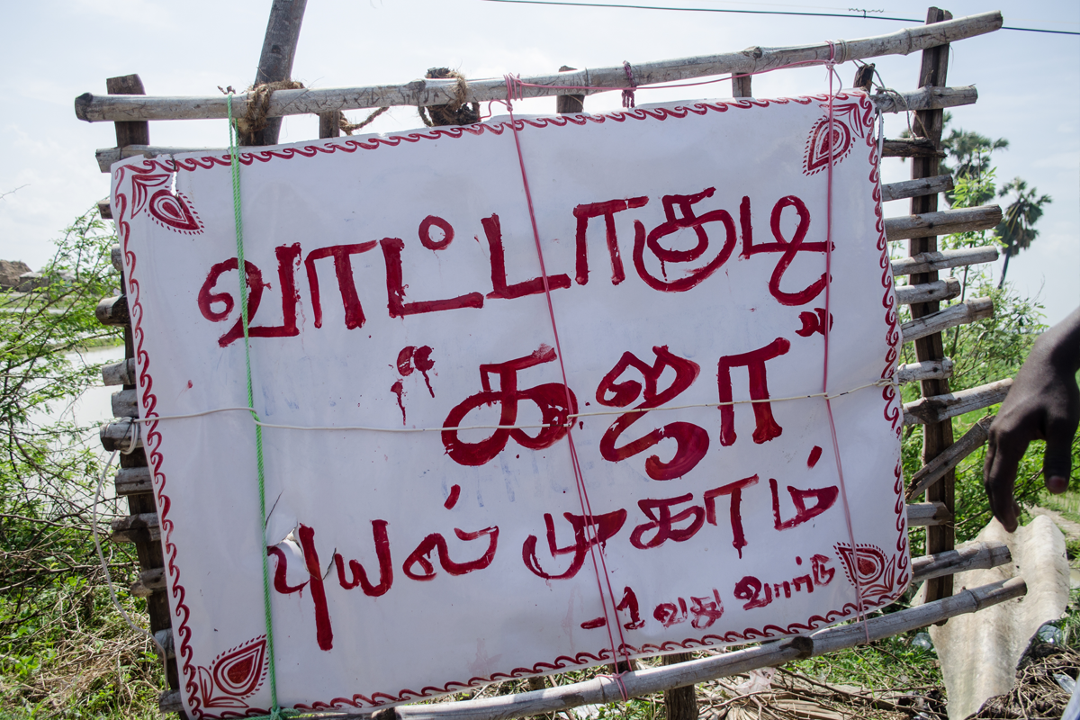 """The board says """"Vaatakudi Gaja Cyclone Relief Centre"""". They are installed by citizen volunteers to guide people to relief centres. Photo by Palani Kumar/PEP Collective."""