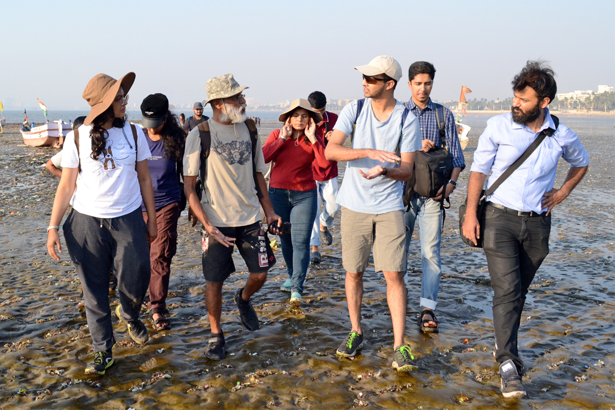Pradip Patade (front and centre) leading a Marine Life of Mumbai shore walk. Photo by Richa Malhotra.