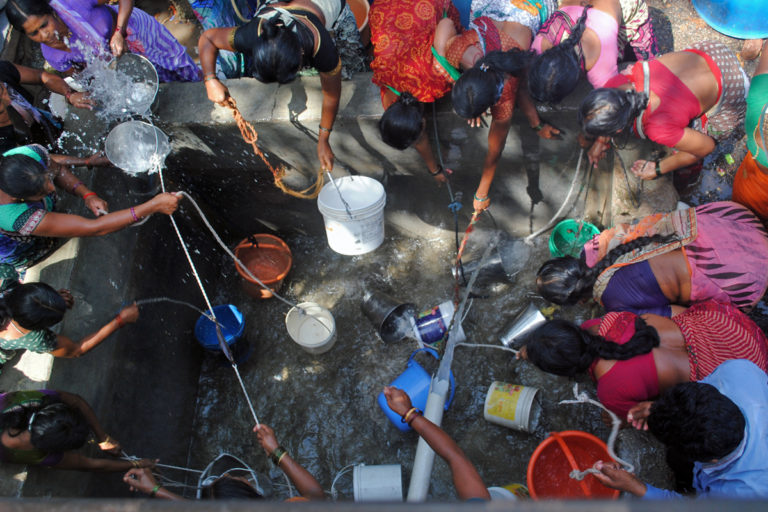 Villagers in Jalna district fill water after the water tanker released water. Photo by Meena Menon.