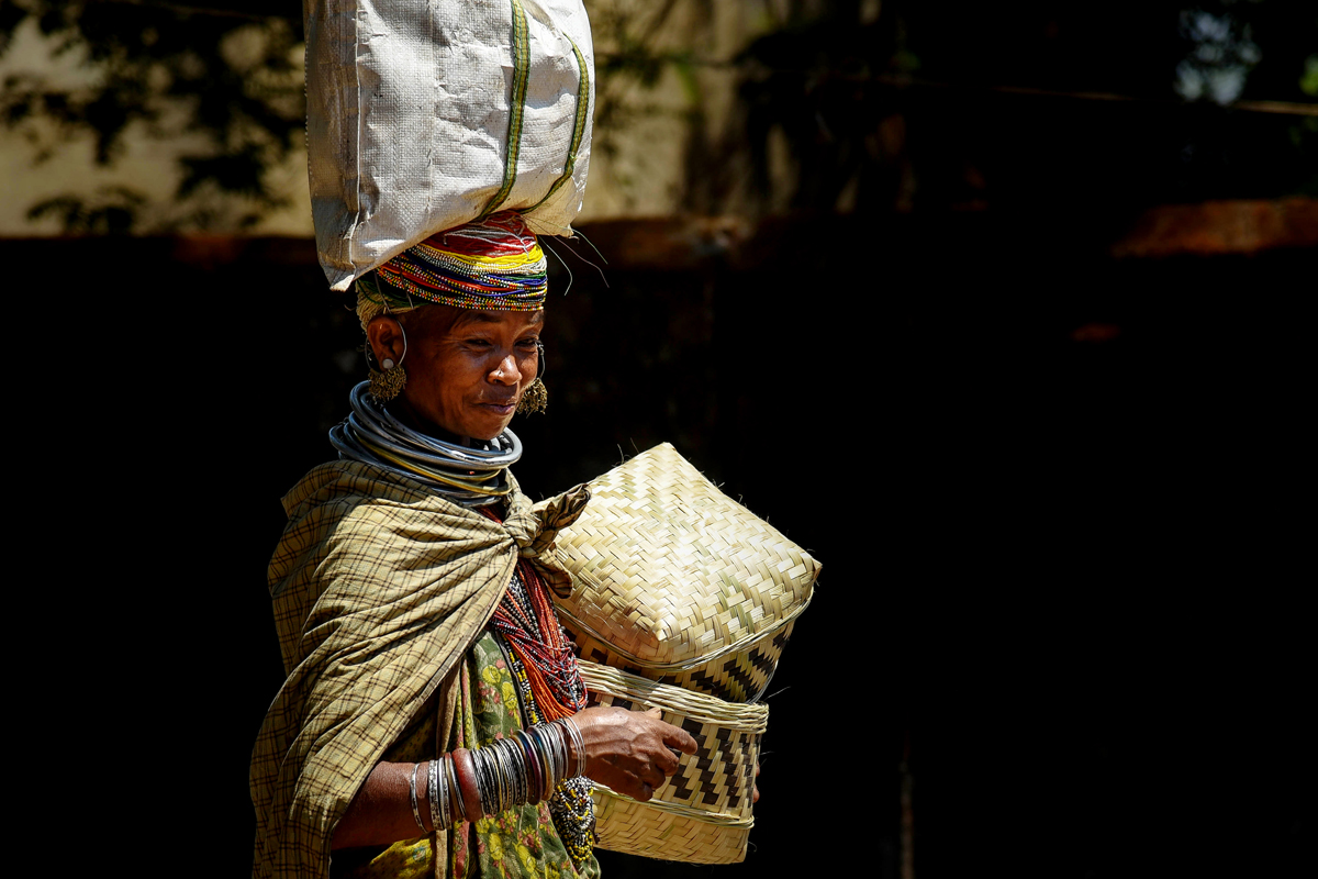 A bonda woman on her way to sell handmade baskets in a local market at Khairput.