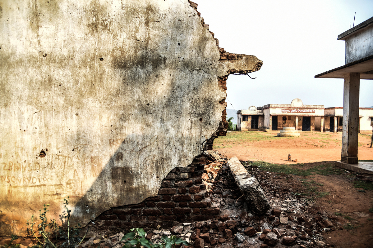 A structure of a school in Malichema collapsed recently. Villagers believe this was due to the constant blasts in the mine. Credit: Tanmoy Bhaduri/MongaBay