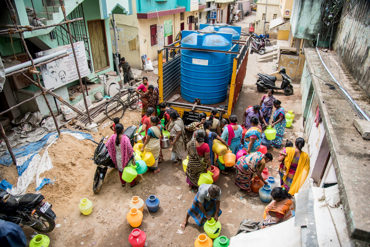 People wait for their turn to fill water. Photo by Steevez Rodriguez/PEP Collective.