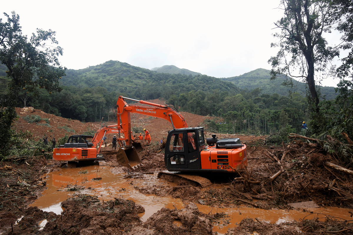 Rescue personnel dig through debris at the site of a landslide. Six bodies were recovered from the spot and four persons are still missing. Photo by Abhishek N. Chinnappa.