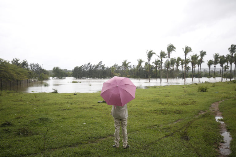 A farmer looks at his fields inundated by the Cauvery river during the floods in August 2019. Photo by Abhishek N. Chinnappa.