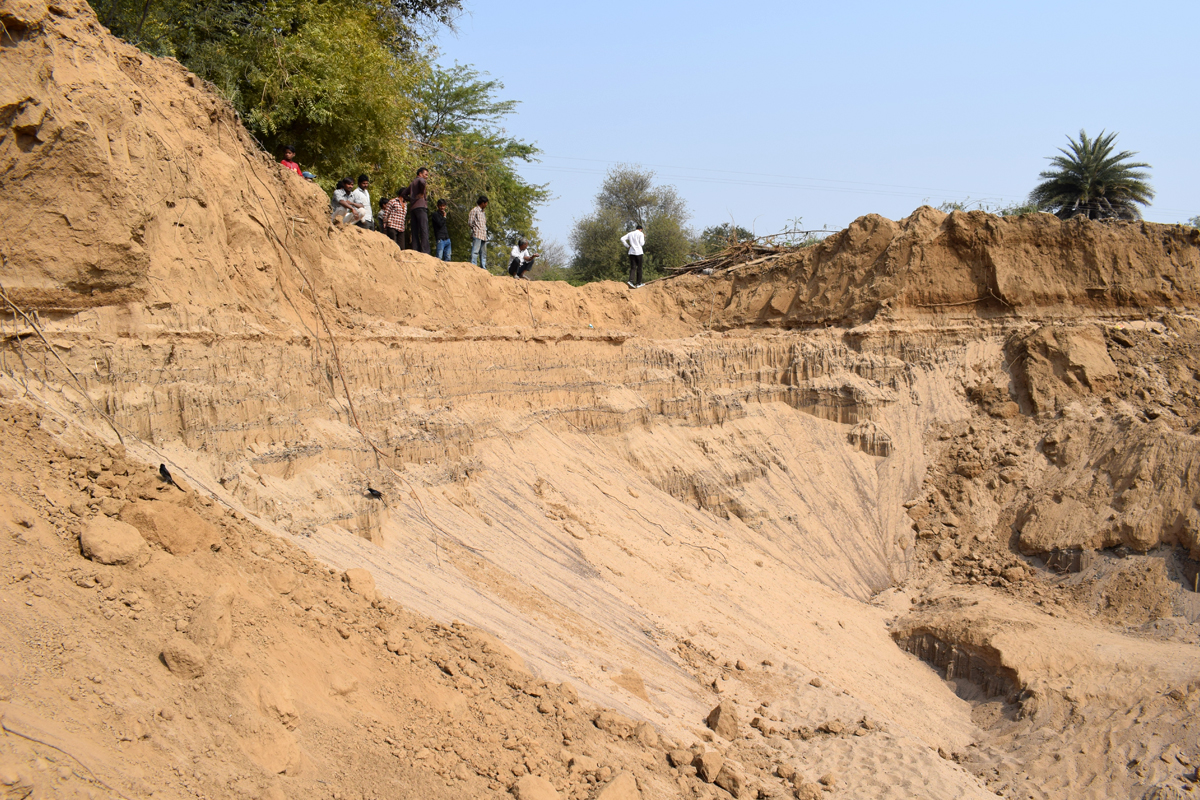 Excessive sand mining at the banks of Narmada has destroyed the river bed and catchment area, affecting the fish population. Photo by Hridayesh Joshi.