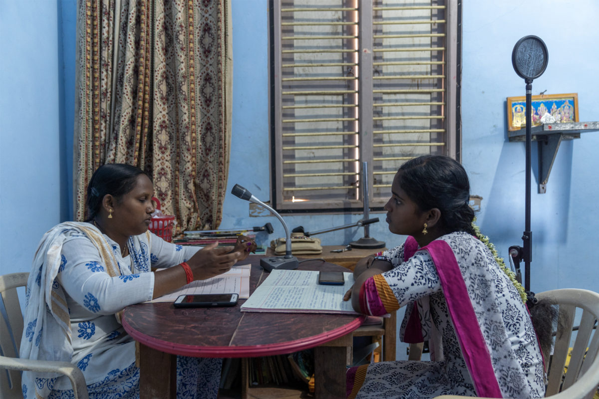 Ranjitha (L) and Durga (R) record a radio show at the community radio station about disaster preparedness in the coastal villages of Nagapattinam district. Photo by Kartik Chandramouli/Mongabay.
