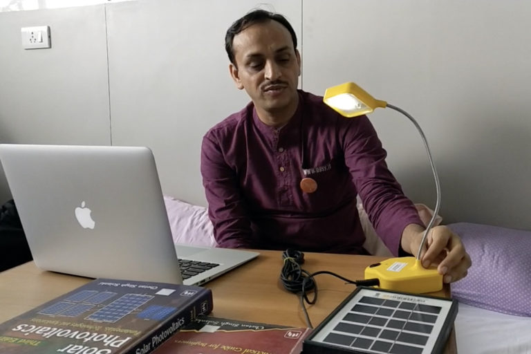 Chetan Singh Solanki, at Indian Institute of Technology, Mumbai, demonstrates the solar lamp made by the SoULS Initiative. Photo by Kanchan Srivastava.