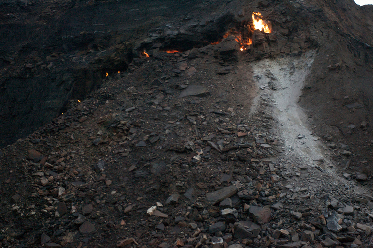 A fire of burning coal in a coal mine in Jharia, Jharkhand. The region is one of the most important coal mines in India and one of the largest in Asia. Photo by Peter Caton/Greenpeace.