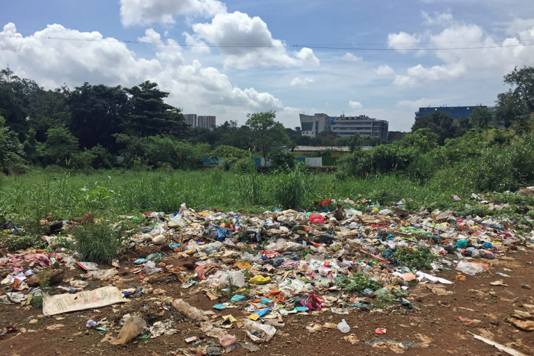 Garbage scattered near a housing settlement in Mumbai. The region tops the list of metros in terms of solid waste generated every day. Photo by Kartik Chandramouli/Mongabay.