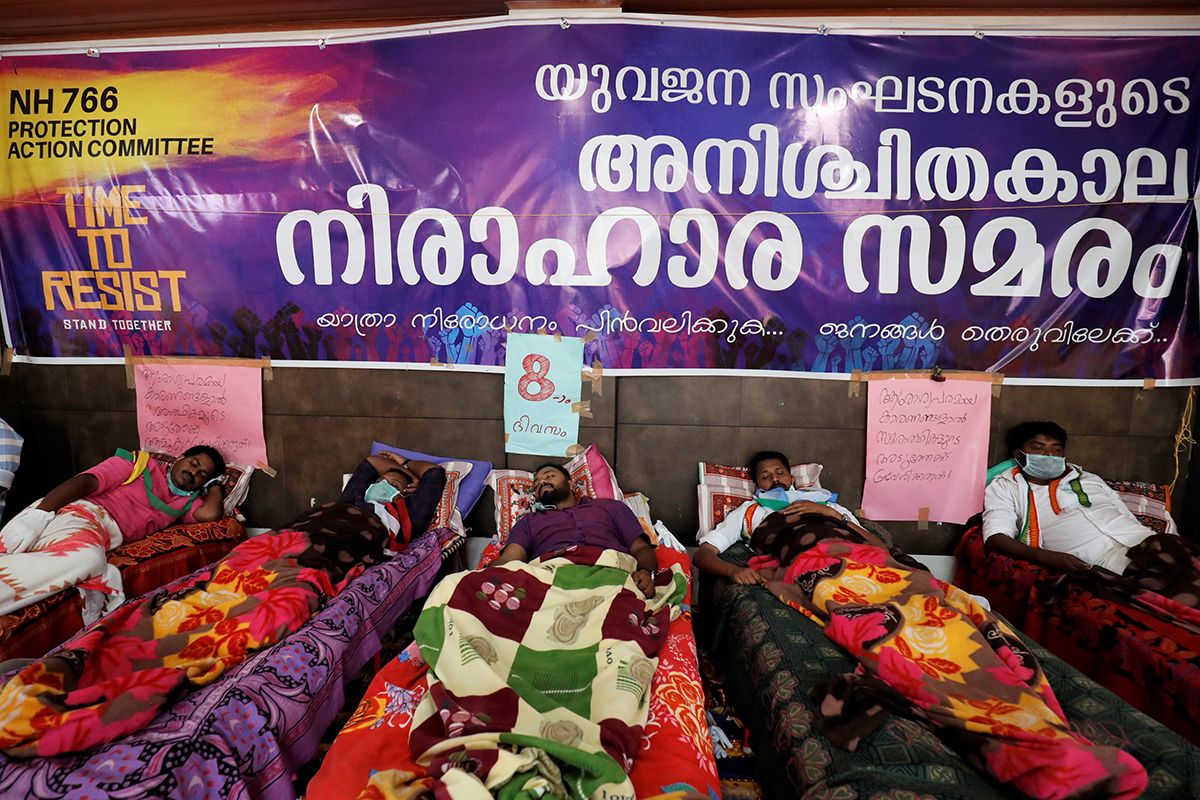 Protestors on an indefinite hunger strike rest during a protest against the NH766 night traffic ban. Photo by Abhishek N. Chinnappa.