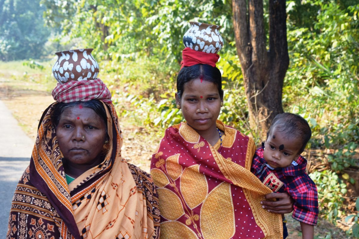 Farmers with seed pots on the way to the indigenous seed festival, a celebration for the farmers of 18 villages who have revived the practice of growing indigenous crops. Photo by Basudev Mahapatra.