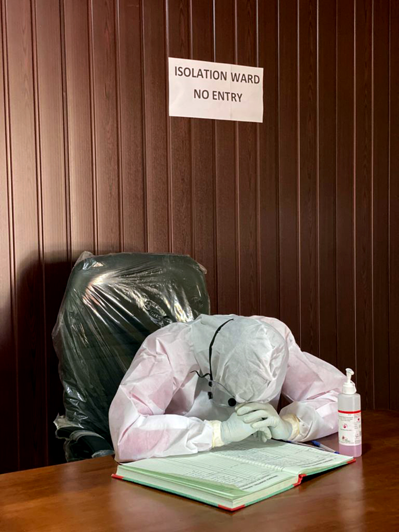 A healthcare worker at the reception of an isolation ward at a government hospital in Kannur, Kerala. Photo by S K Mohan.