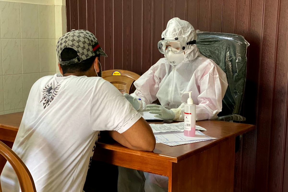 A person suspected to be infected by COVID-19 enrolls himself at an isolation camp in Kannur, Kerala. Photo by S K Mohan.