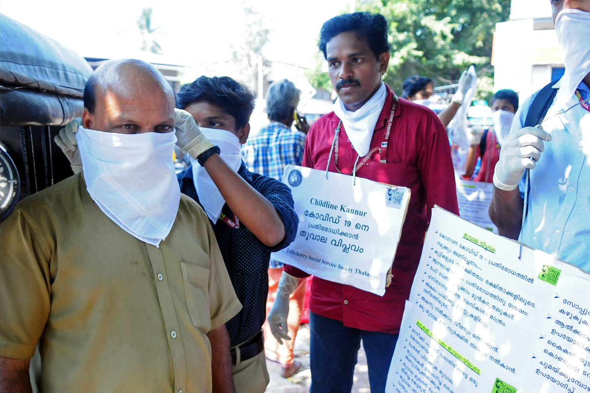 Social workers in Kerala spread awareness about COVID-19 and provide masks and cloth for protection. Photo by S K Mohan.