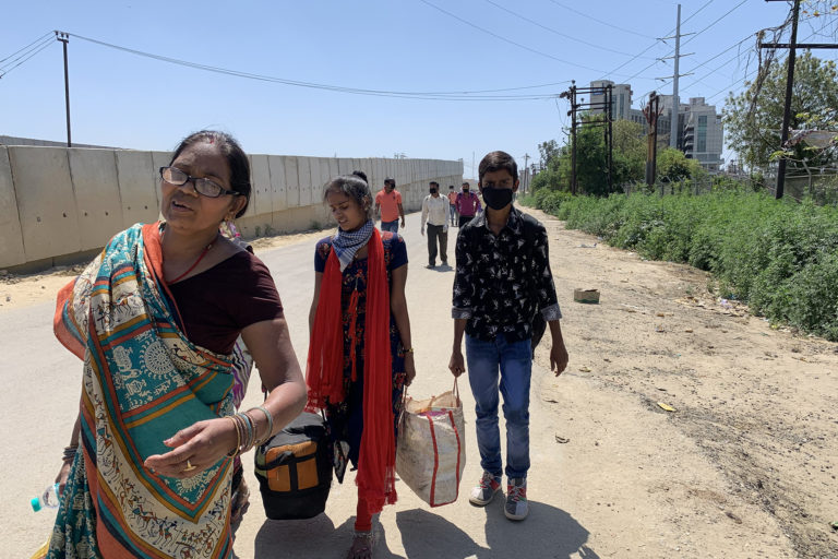 Migrants walk from Delhi to their homes in Ghaziabad after the national COVID-19 lockdown was imposed. Photo by Prerna Prasad.