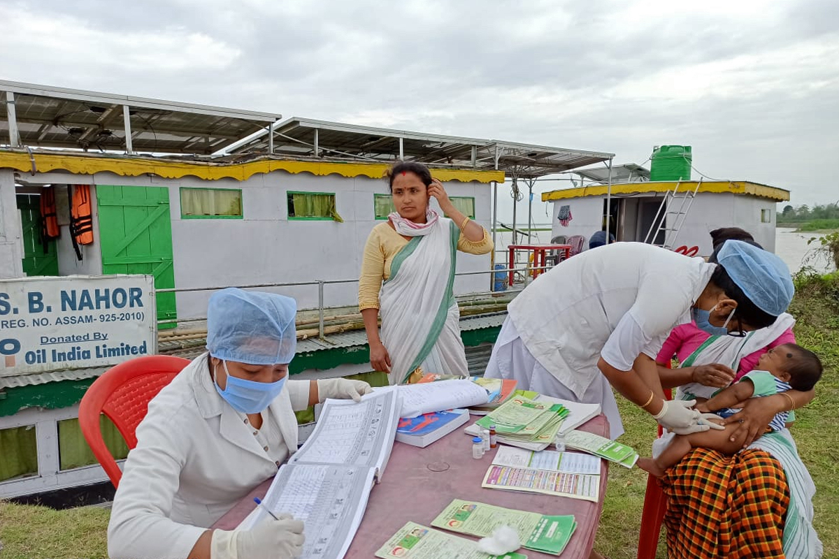Health workers from the Jorhat Boat Clinic provide routine immunisation during the COVID-19 lockdown. Photo from Jorhat Boat Clinic.