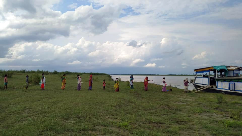 Women and children attend a routine immunisation camp conducted by the boat clinic. This service provides basic health care facilities to the riverine islands on the Brahmaputra river in Assam. Photo from Centre for North East Studies and Policy Research (C-NES).