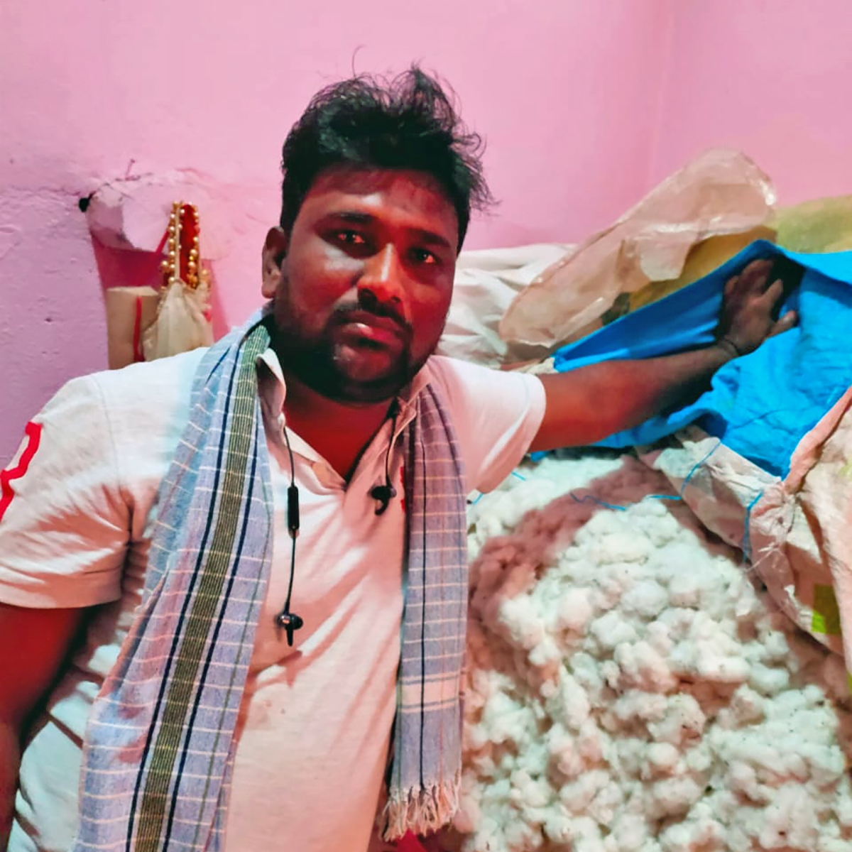 Kiran Pawar, a farmer from Latur, Maharashtra shows his cotton produce left unsold due to the COVID-19 lockdown. Photo from Kiran Pawar.