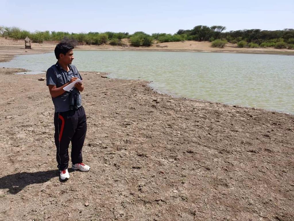 Radheshyam Bishnoi, one of the volunteers with the Godawan (GIB) Community Conservation project, collecting data. Photo from Radheshyam Bishnoi.