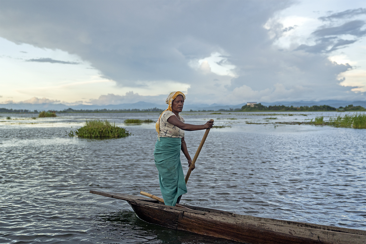 A fisherwoman in Loktak Lake, Manipur. The fisheries sector claims to support nearly 16 million fishers and fish farmers. Photo by Kartik Chandramouli/Mongabay.