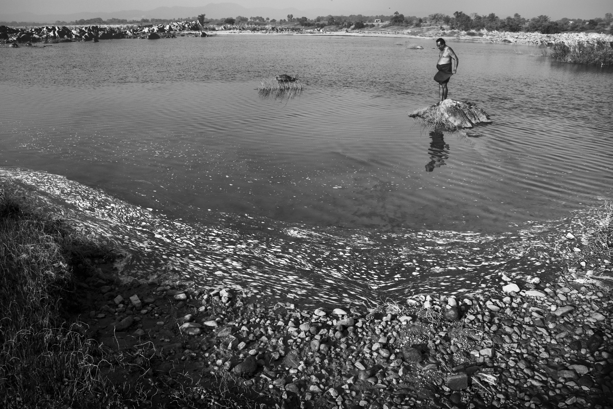 Subarnarekha river near Jaduguda that serves as a water source for villages. The toxic waste from the uranium processing factory and tailing ponds has contaminated the river causing severe health hazards argue residents. Photo by Subhrajit Sen.