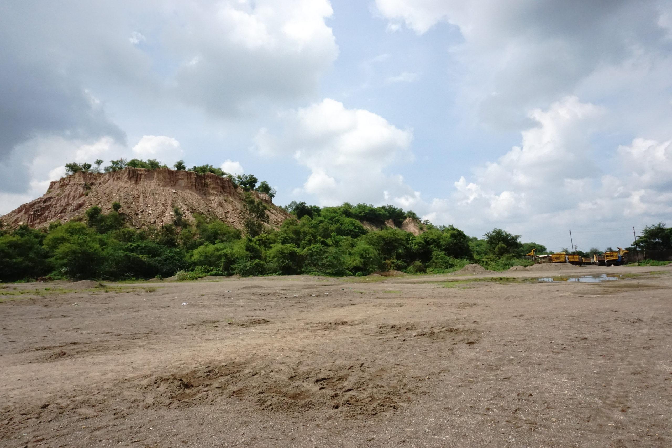 Overburden block or waste from mining has vegetation of Prosopis species providing smooth wildlife corridor between the TATR and CSTPS. Photo by Saurabh Katkurwar