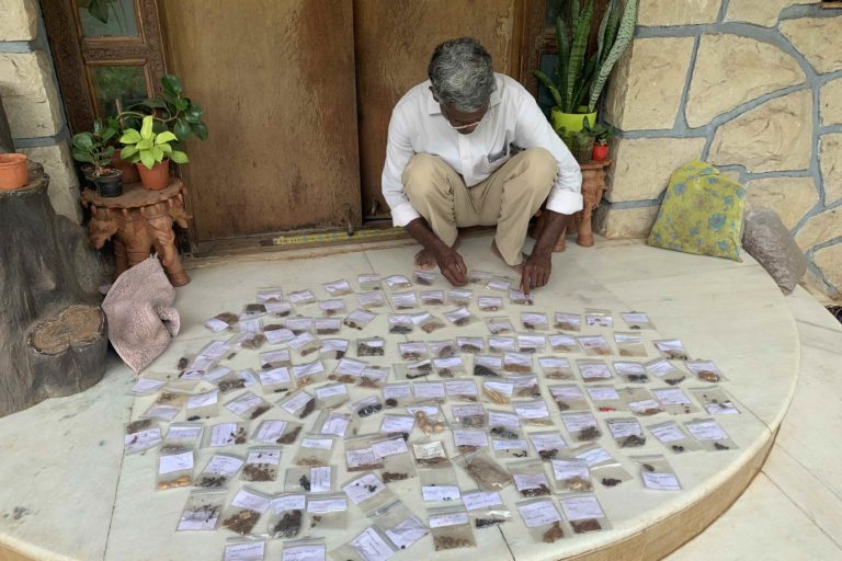 Raghunath Dhole arranging seed samples