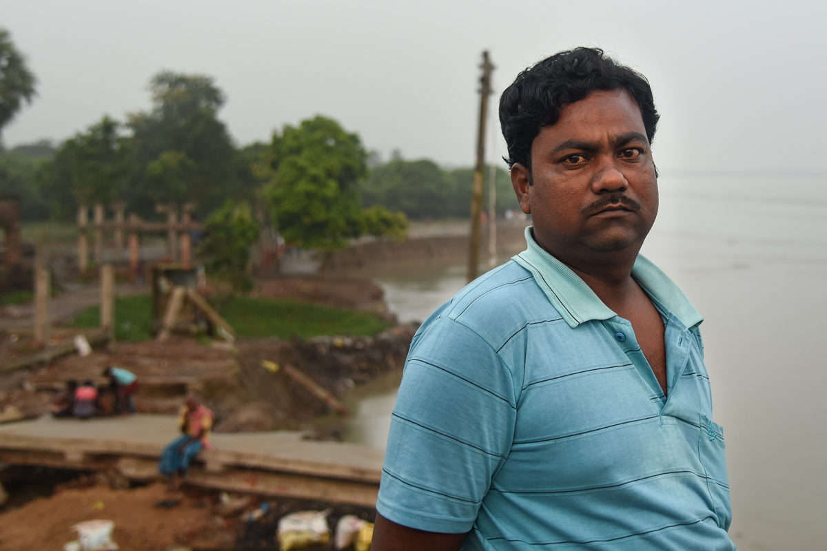 """Raisuddin Seikh lost his house and ten bighas of land in the recent erosion at Dhanghara village. """"I saw the river water in my courtyard when we came out around 1 am-midnight. We heard a strange sound when the house started sinking and it did not give us time to shift essential items."""" Photo by Tanmoy Bhaduri."""