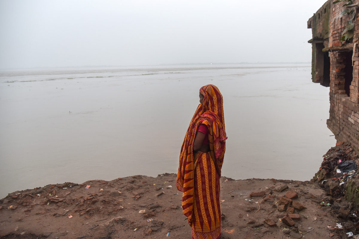 Anwara Bibi, a widow residing at Dhanghara village, looks at her house that was washed away on August 19 midnight. Photo by Tanmoy Bhaduri.