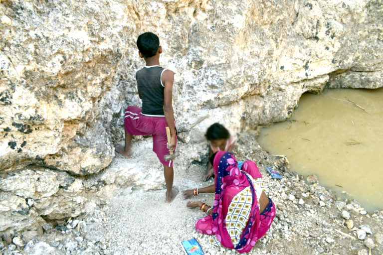 A woman and her children collect mica from an abandoned mine in Tisri block of Koderma district in Jharkhand. Photo by Vinay Murmu.