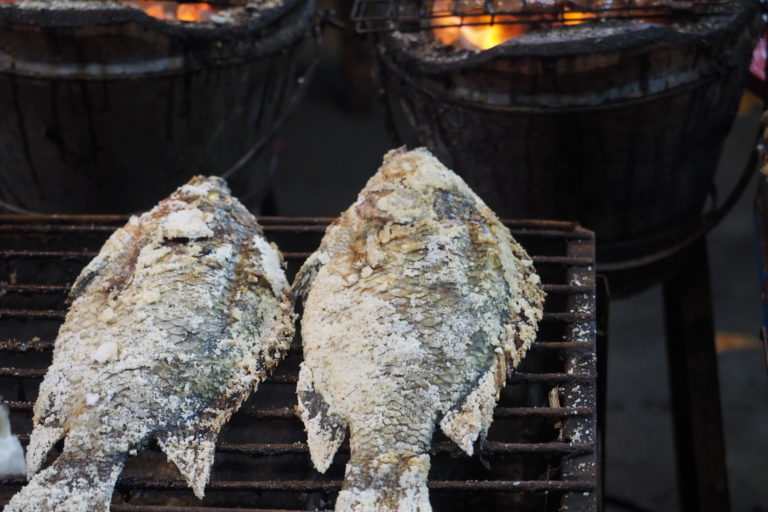 Pla Plao, salt crusted charcoal grilled tilapia, one of Thailand's street food delicacies. Photo by Aaron Savio Lobo.