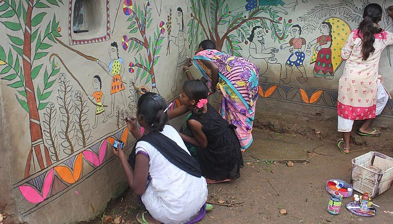 Tribal life depicted in murals. Photo by Md Khurshid.