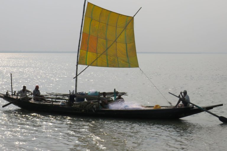 A fisherman on a boat with fishing nets near Diamond Harbor in Sundarbans.Photo by Namrata Acharya.