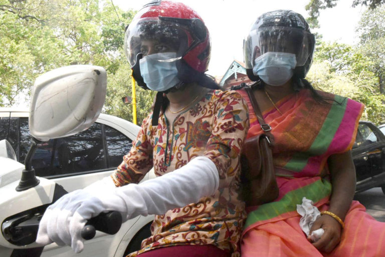 A mother and daughter travel on a two-wheeler in Kochi with masks amid reports that new Covid-19 cases are increasing in Kerala's urban areas.Photo by Deepaprasad T.K.