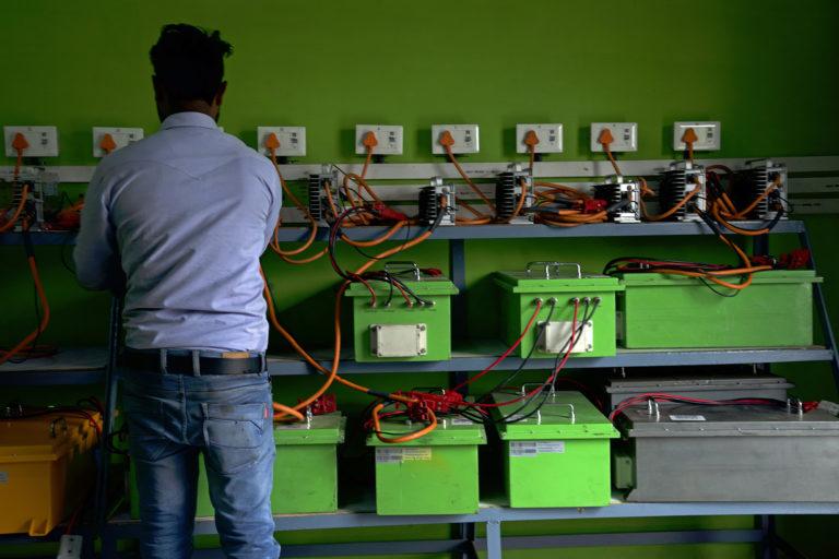 An electric rickshaw battery charging hub in Varanasi. Photo by Kartik Chandramouli.
