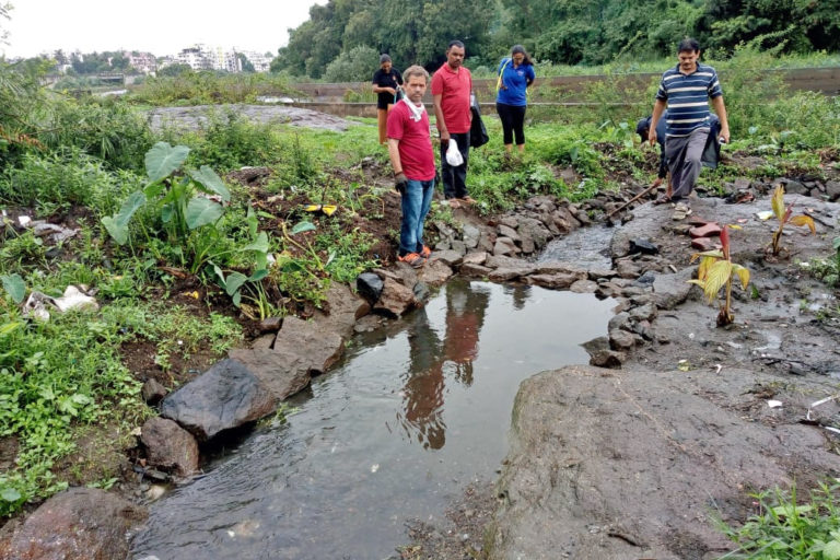 Volunteers place stones to help channelise the water flow into the Mutha river, conduct cleaning drives along the river bank and plant aquatic plants. Photo from Jeevitnadi.
