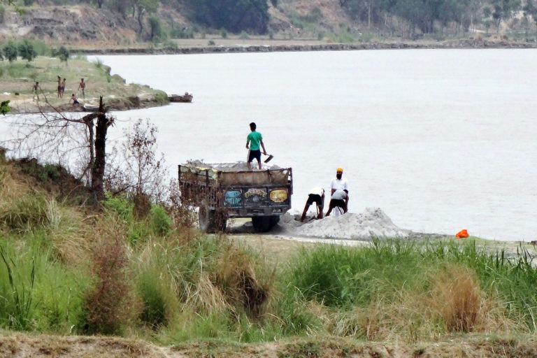 Sand mining in Beas river is one of the main threats to the river ecosystem. Photo from India Water Portal.