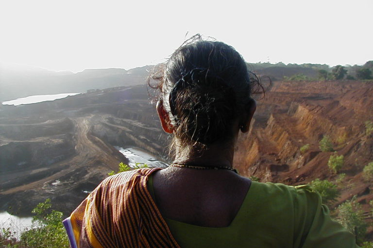 Villager looking at mining devastated areas in Goa, India. Photo by Frederick Noronha/Wikimedia Commons.