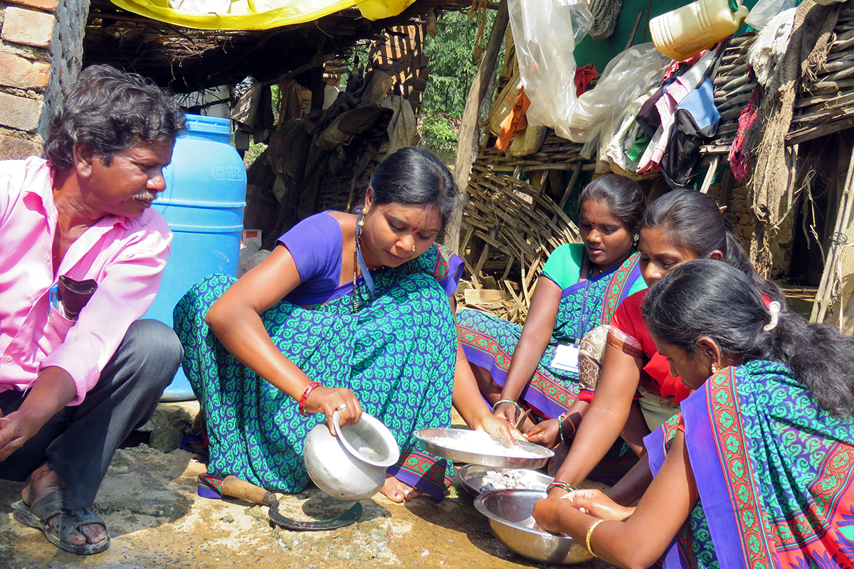 Shalu Kolhe from Gondia teaches the process of making fish pickle. She formed self-help-groups of fisherwomen and brought woment at the forefront of developmental activities. Photo from