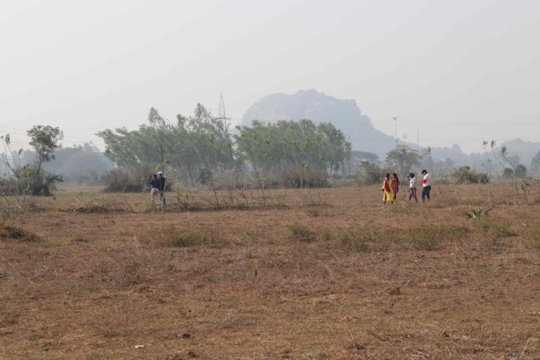 Tourists on the outskirts of Bhetnoi trying to trace and capture blackbucks in their cameras. Photo by Manish Kumar.